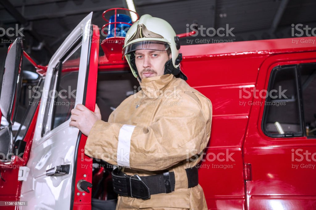 Emergency safety. Protection, rescue from danger. Fire fighter in...