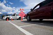 Vehicle stopped in front of police car and sign that reads emergency scene ahead.Utahlypse 2011