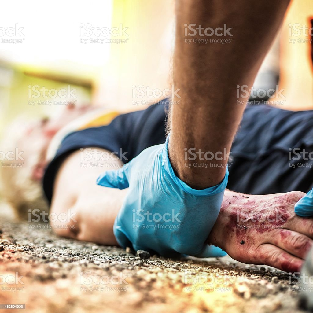 Emergency service rescuing a victim of an accident stock photo