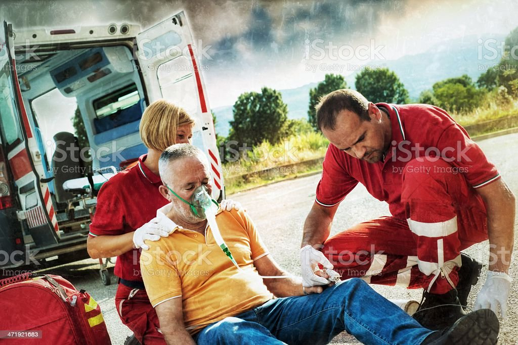 Emergency service team rescuing man after a heart attack royalty-free stock photo
