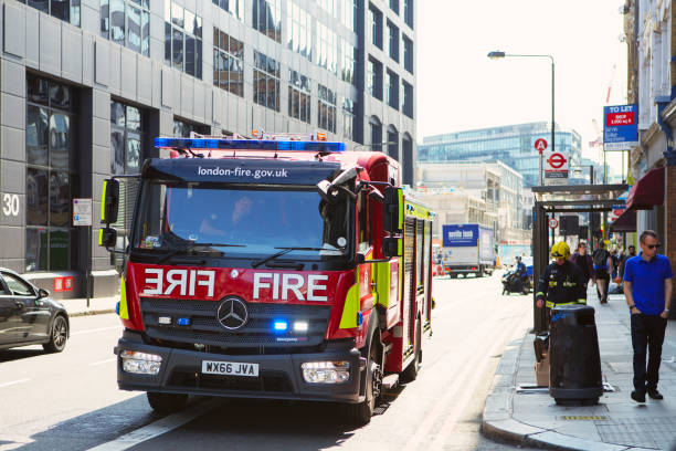 emergency services firefighters from the london fire brigade respond to an emergency in the street near the farringdon station - dept stock pictures, royalty-free photos & images