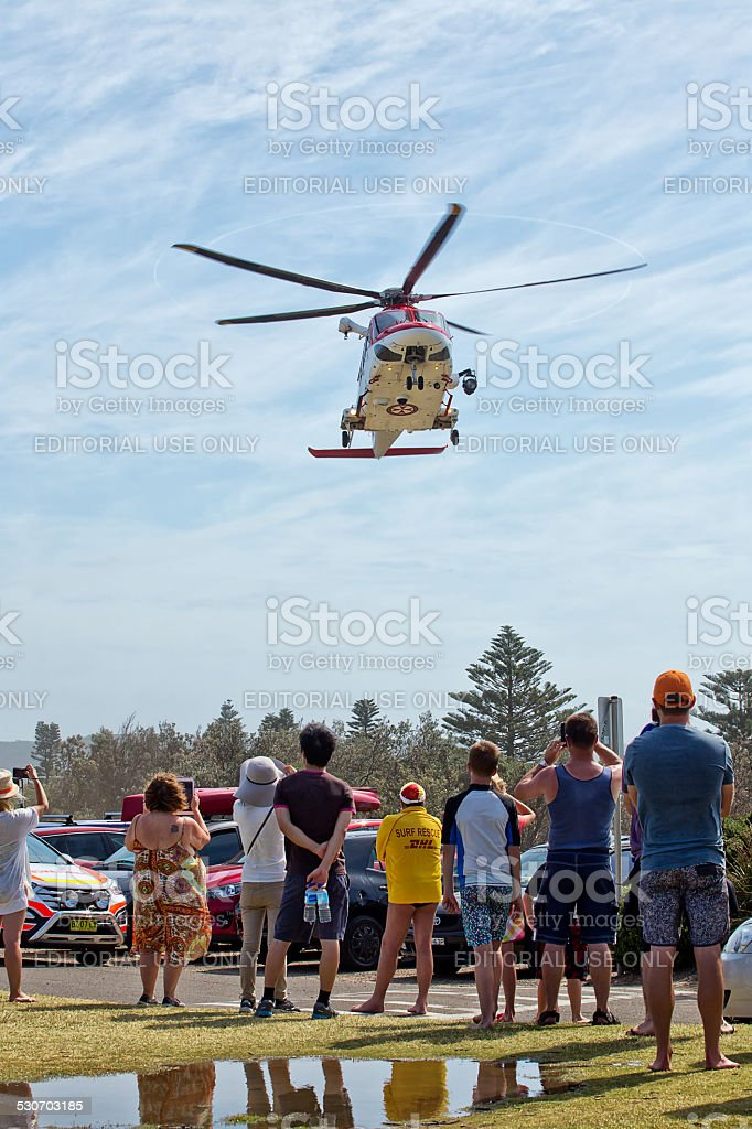 Emergency services rescue a man from drowning stock photo