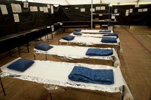 an emergency shelter or emergency sleeping place, refuge for people
