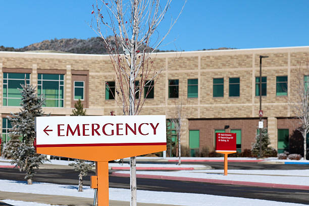 Emergency Sign and Hospital Building Exterior