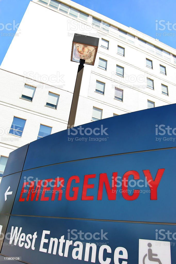 This is a picture of an emergency sign in front of a hospital. Top...