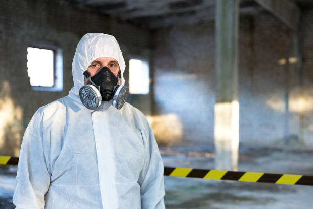 emergency situations specialist stands inside the building where the accident occurred. - apparato respiratorio foto e immagini stock