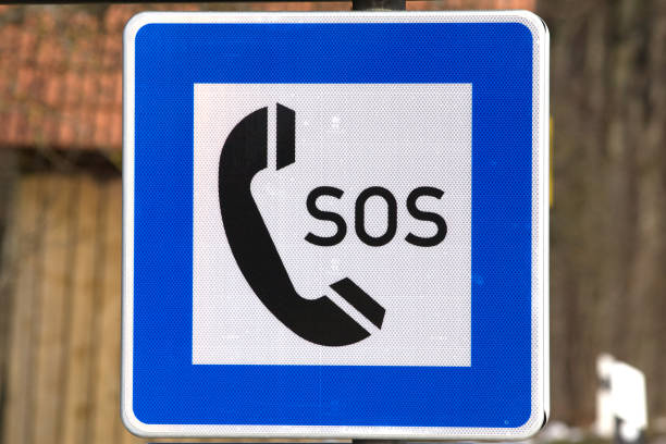 emergency SOS phone sign for help in germany stock photo