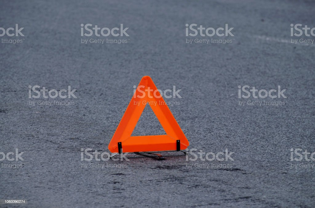Emergency stop sign.This is a warning to other drivers about an...