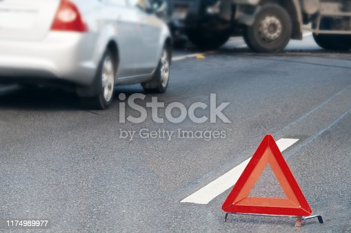 istock Emergency stop sign placed in front of colliding vehicles 1174989977