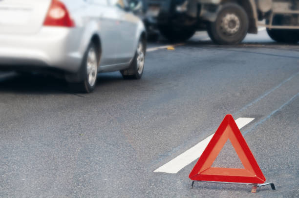 Emergency stop sign placed in front of colliding vehicles Emergency stop sign placed in front of colliding vehicles on the road traffic accident stock pictures, royalty-free photos & images