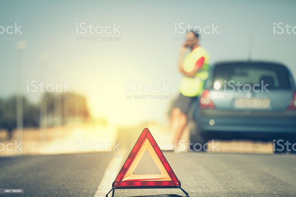 Emergency triangle in the middle of road. stock photo