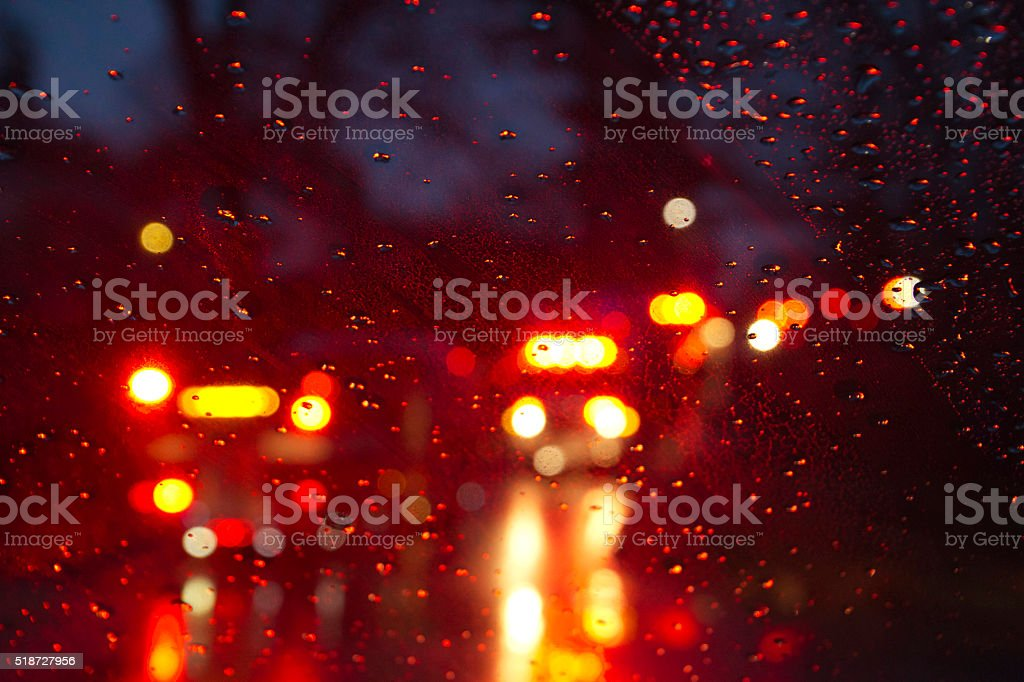 Emergency Vehicles Flashing Through a Wet Windshield Darkly bildbanksfoto