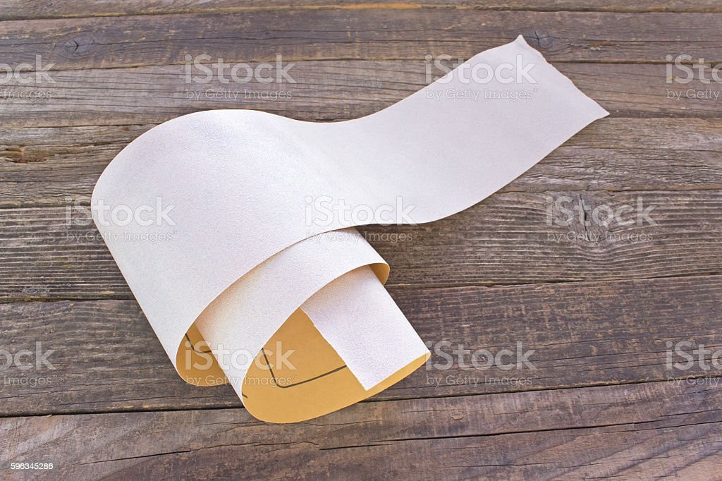 Emery paper - sandpaper on old wooden board royalty-free stock photo