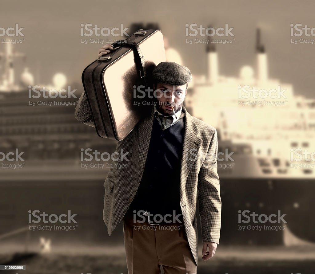 Emigrant with a transatlantic ship behind stock photo