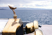 Opatija, Сroatia - June 25, 2013: The front end of the beautiful old Rolls Royce with the hood ornament, Spirit of Ecstasy, parked on waterfront of Opatija harbor. The ornament is in the form of a woman leaning forwards with her arms outstretched behind and above her. Billowing cloth runs from her arms to her back, resembling wings.