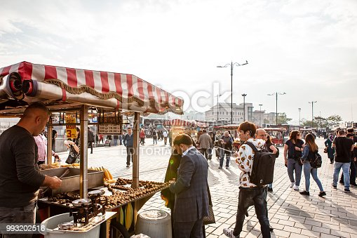 Istanbul, Turkey - May 9, 2018: Street vendors selling hot corn and chestnut in Eminönü district. Eminönü is a place that tourists love very much. Here is a very colorful view of Istanbul.