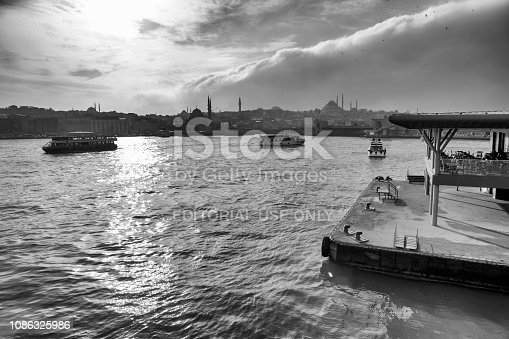 Istanbul, Turkey -  Dec 21, 2018: Eminonu district with many facilities to eat such as floating restaurants and carts with fresh bakery, hot corn or roasted chestnuts in Istanbul, Turkey.