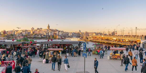 Eminonu Piazza with floating seafood restaurants and city view including Galata Tower and Galata bridge, Istanbul, Turkey stock photo