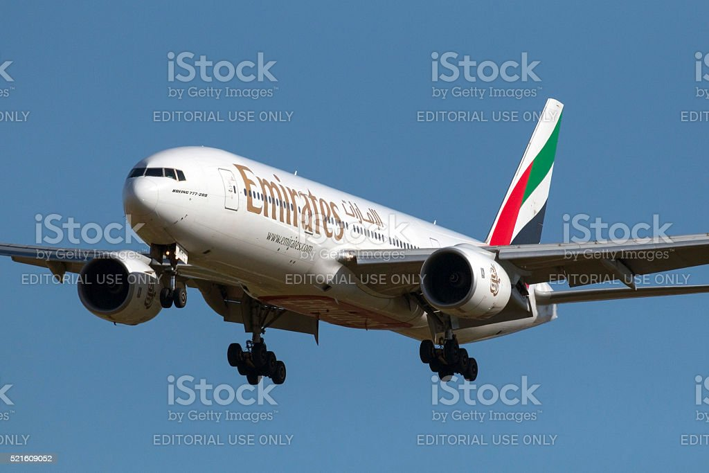Emirates 777 on short finals stock photo