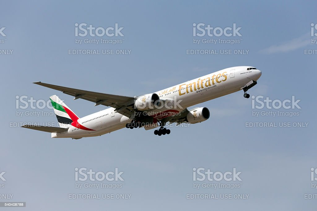 Emirates 777 taking off from runway 13 stock photo
