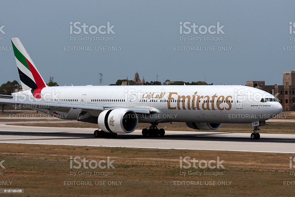 Emirates 777 thrust reversing after landing. stock photo