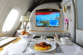 Dubai, United Arab Emirates - March 31, 2015: Emirates Airbus A380 first class private suite interior. Emirates is one of two flag carriers of the United Arab Emirates along with Etihad Airways and is based in Dubai.