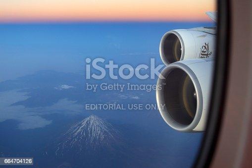 istock Emirates Airbus A380 wing view (Damavand volcano seen). 664704126