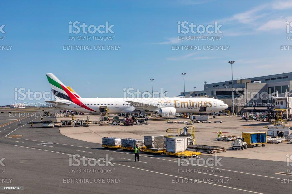 emirates aircraft at  passenger bridge at logan international airport in Boston stock photo