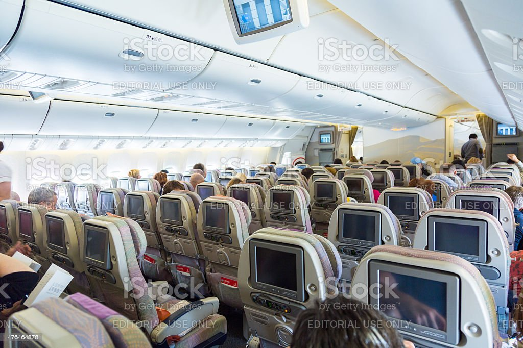 Emirates boeing 777-300 economy class interior stock photo