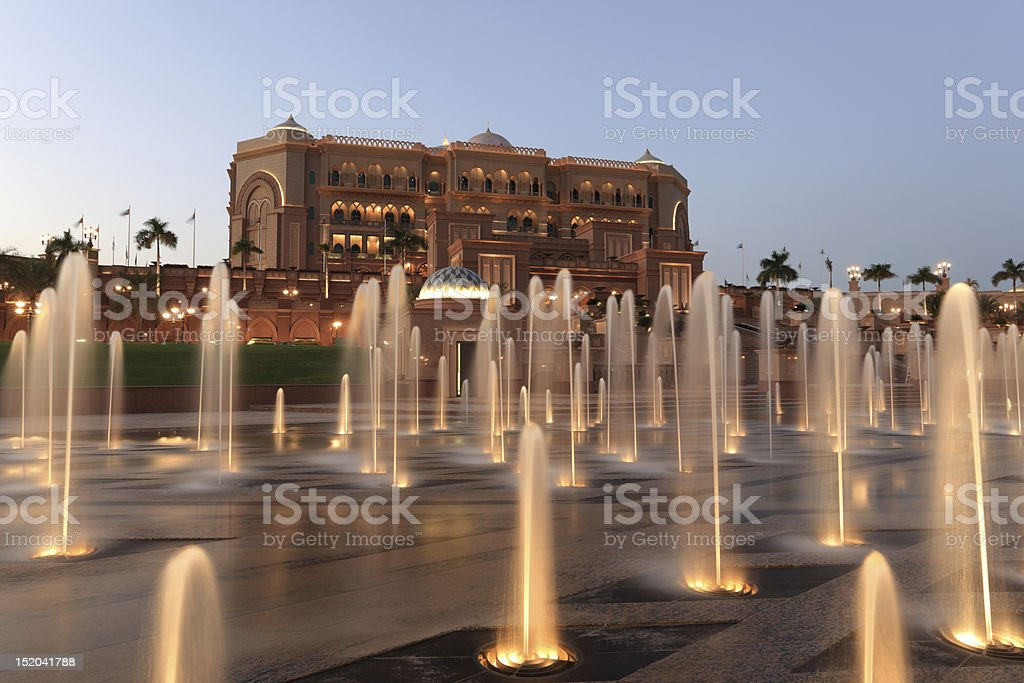 Emirates Palace at night at Abu Dhabi stock photo