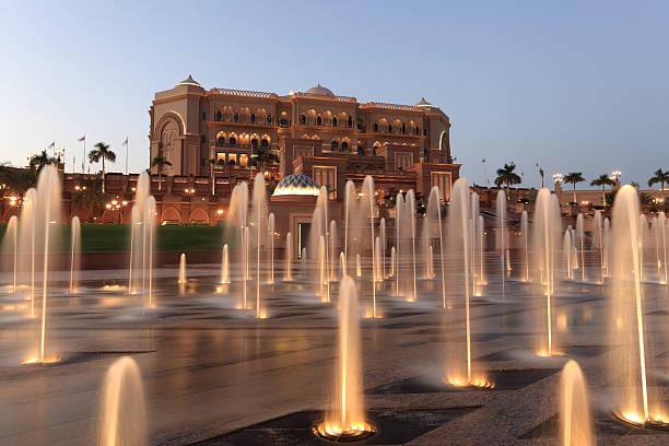 emirates palace at night at abu dhabi - palats bildbanksfoton och bilder