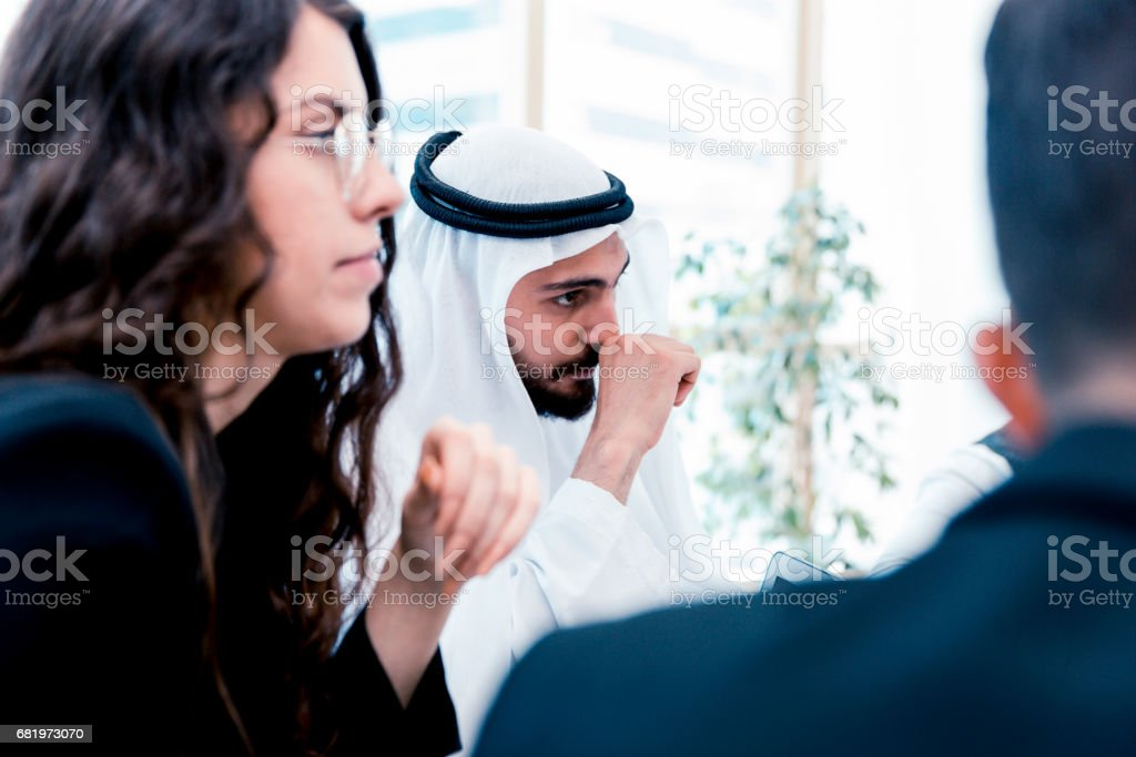Emirati Arab Businessman listening to the group of talented business executives stock photo