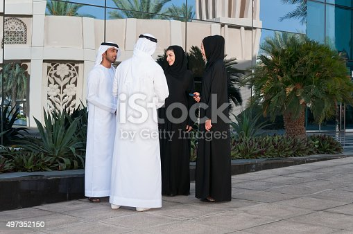471250190istockphoto Emirati Businessmen and Businesswomen Meeting Outside Office Building, Dubai, UAE 497352150