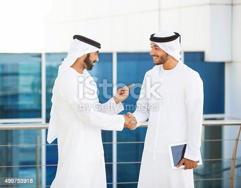 471250190istockphoto Emirati Businessmen Meeting Outside Office 499753918