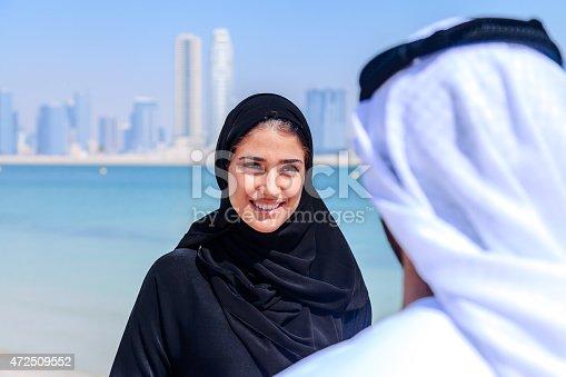 471250190istockphoto Emirati couple talking 472509552
