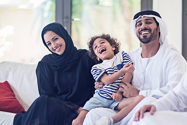 Emirati family portrait Portrait of a middle eastern family looking at the camera. arabic style stock pictures, royalty-free photos & images
