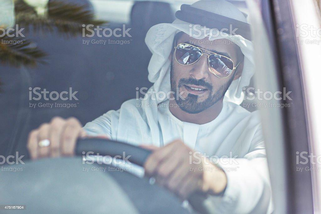 Emirati man driving his car stock photo