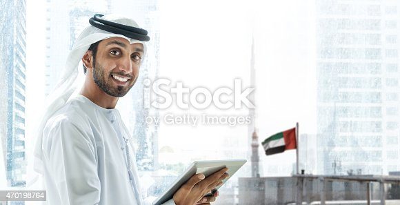 istock Emirati smiling businessmen in Dubai with tablet 470198764