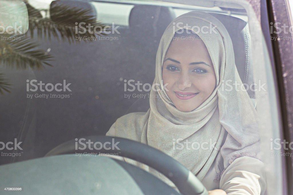 Emirati woman driving a car stock photo