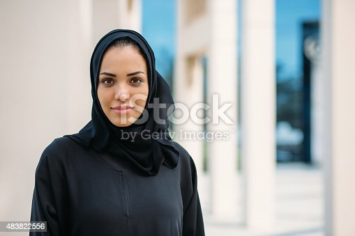 Portrait of young woman in traditional arabic clothes.