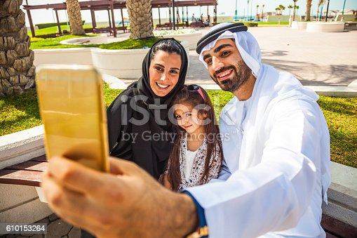 472869308 istock photo Emirati young family in Dubai taking a selfie 610153264