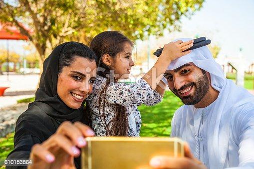 472869308 istock photo Emirati young family in Dubai taking a selfie 610153864