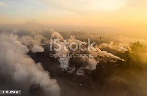 Emission to atmosphere from industrial pipes. Smokestack pipes shooted with drone. Night scene