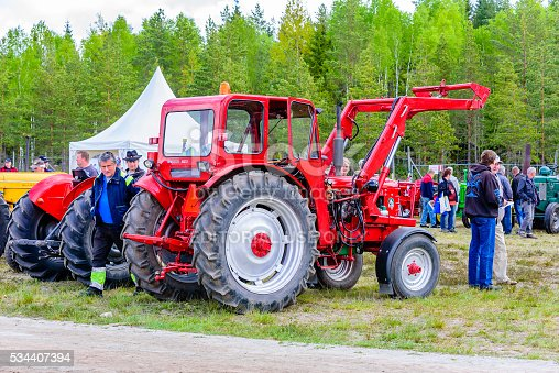 Emmaboda, Sweden - May 14, 2016: Forest and tractor (Skog och traktor) fair. People looking at vintage classic tractors. Here a red 1959 BM Boxer with front loader.
