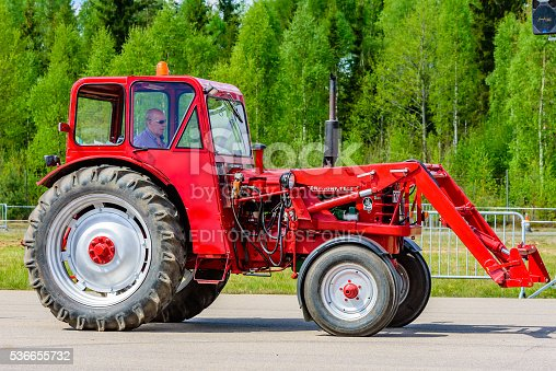 Emmaboda, Sweden - May 14, 2016: Forest and tractor (Skog och traktor) fair. Vintage classic tractors on parade. Here a red 1959 BM Volvo Boxer with front loader.