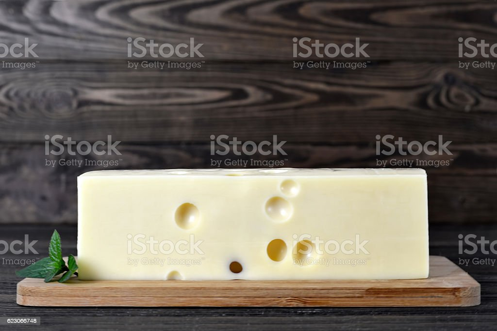 Emmental cheese on wooden board stock photo