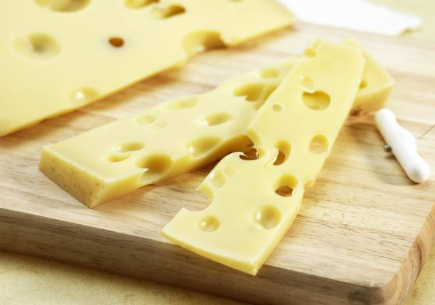 emmental, cheese produced from cow's milk - emmentaler foto e immagini stock
