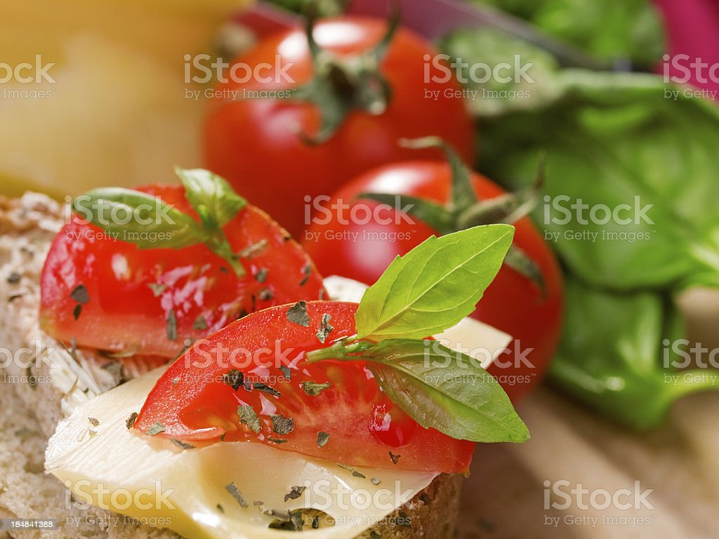 Emmental cheese with tomatos royalty-free stock photo