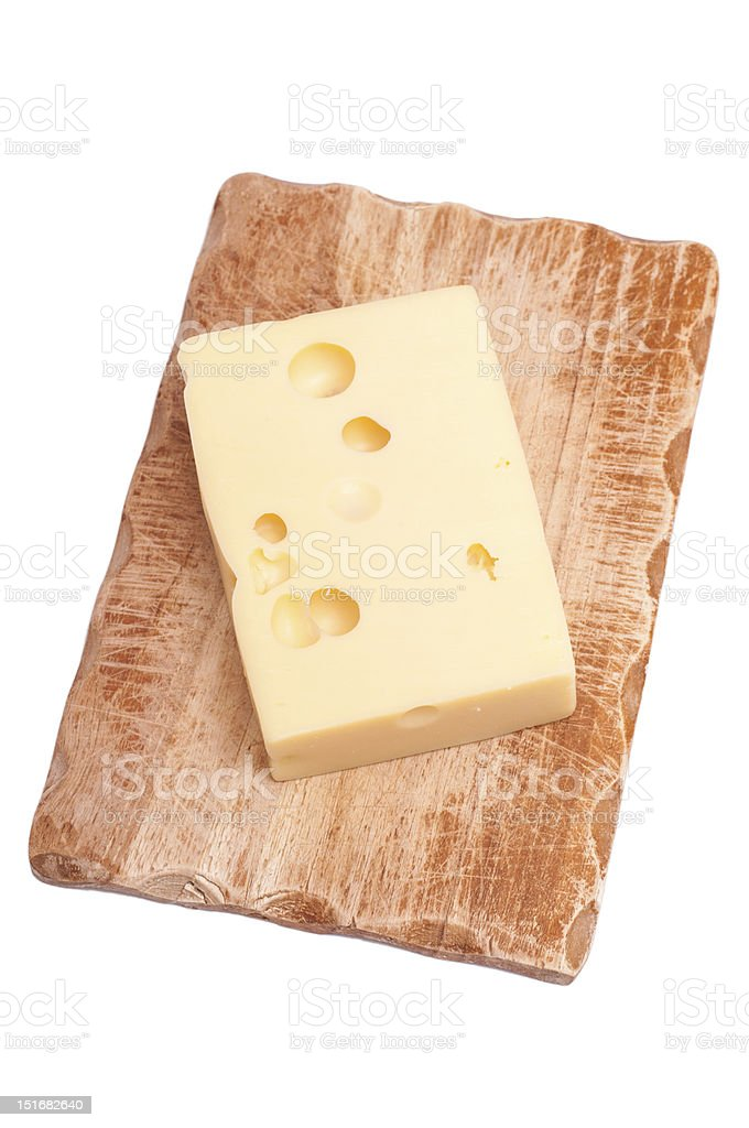 Emmenthaler cheese on wooden board royalty-free stock photo