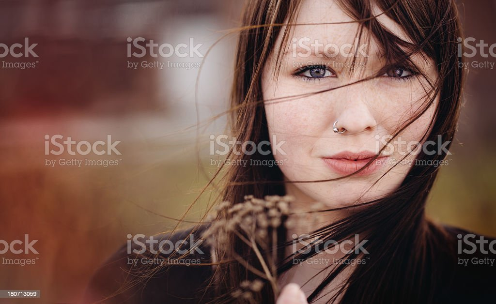 Emo Girl is holding a dead plant stock photo